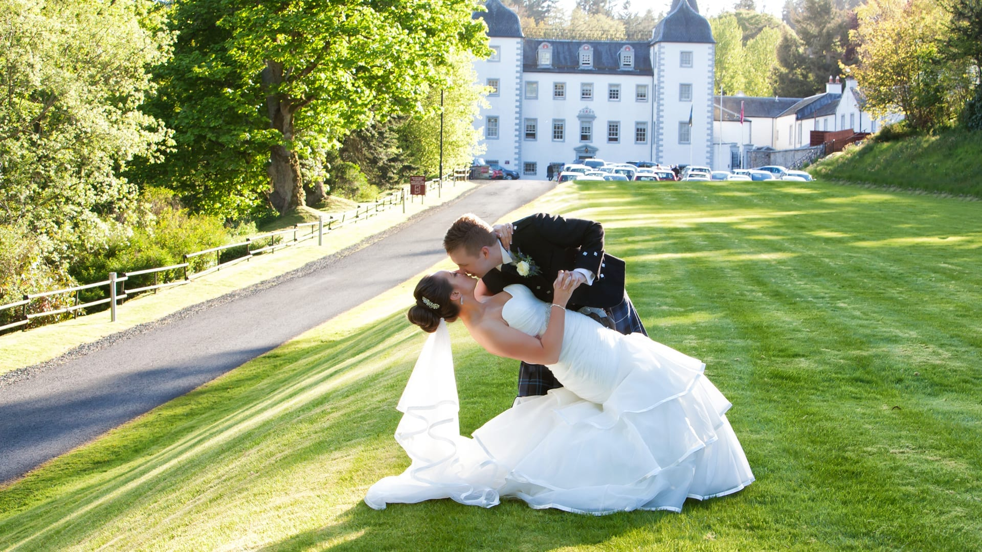 Bridge and groom on lawn at Barony Castle