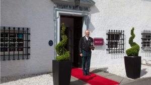 A welcoming doorman at Barony Castle