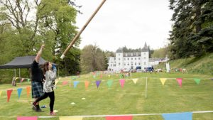 Caber tossing teambuilding exercise at Barony Castle