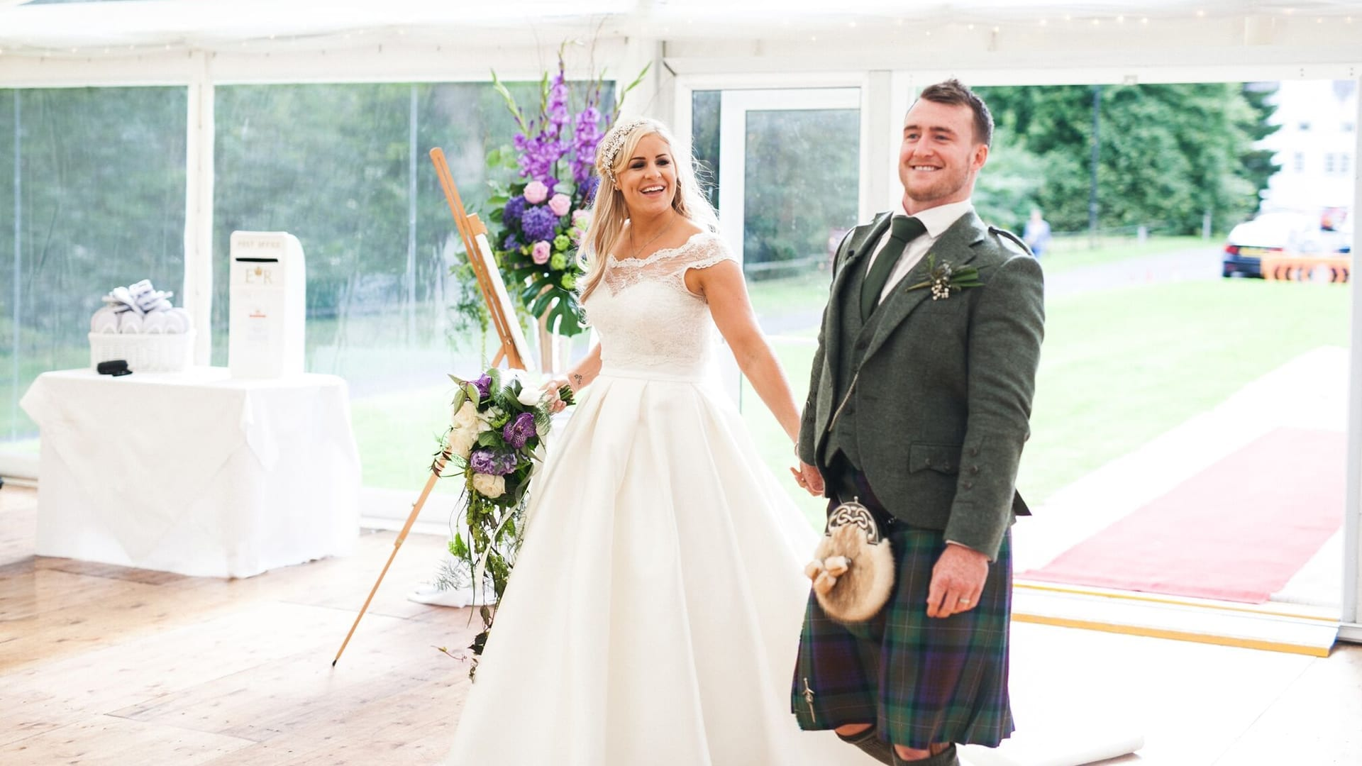 Bride and groom enter the marquee at Barony Castle