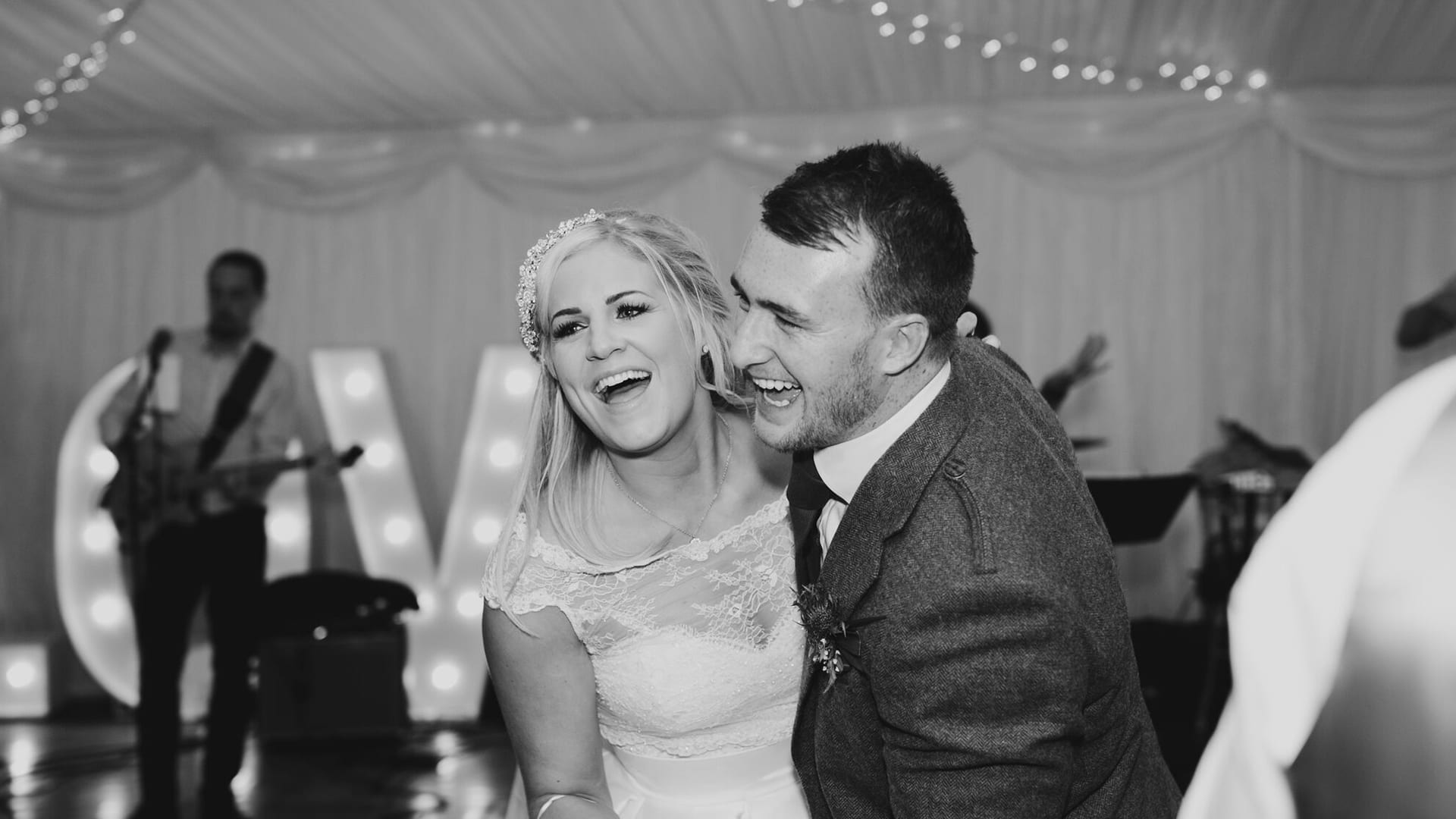 Bride and groom dance in the marquee at Barony Castle