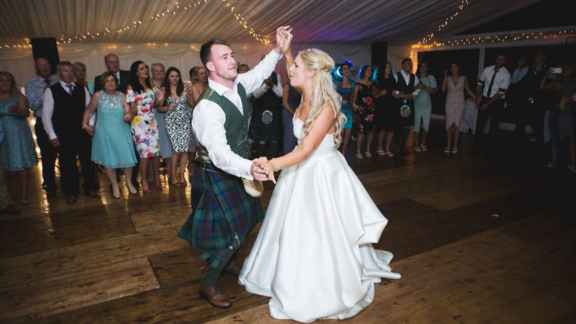 Bride and groom dancing at Barony Castle