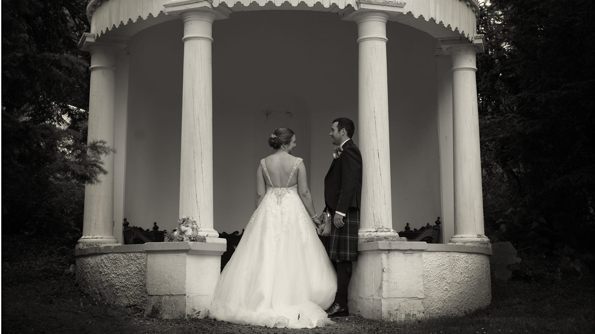 Bride and groom at the Summerhouse in Barony Castle grounds